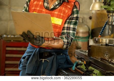 Mechanical Engineering Using A Laptop Computer With Checking Machine In Factory.heavy Industrial Wor