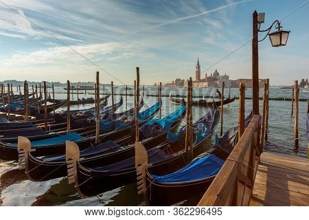 Traditional Gondolas on Canal Grande with San Giorgio Maggiore church in the background at morning, San Marco, Venice, Italy