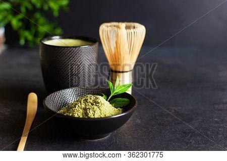 Organic Green Matcha Tea And Tea Accessories On Black Background. Japanese Tea Ceremony Concept. Cha