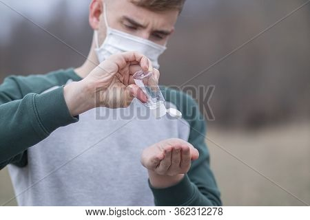 Young Man Using, Applying Sanitizer From Portable Bottle For Disinfect Hands, Guy, Boy In Protective