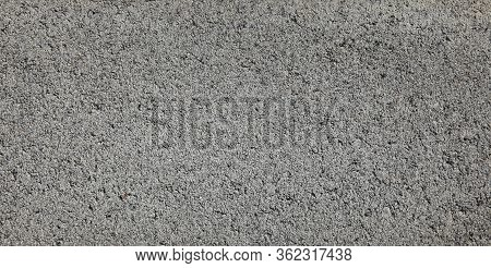 Grey Grainty Surface. Cinder Block Wall, Texture And Background. The Fragment Of A Slag (cinder) Blo