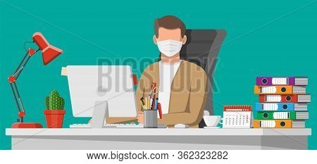 Freelancer Or Remote Worker On Quarantine. Man In Medical Mask Working On His Computer At Desktop. O