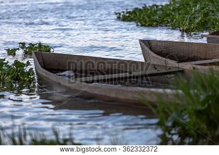 View Of Lake, Aquatic Vegetation And Old Wooden Fishing Boats On The Banks...