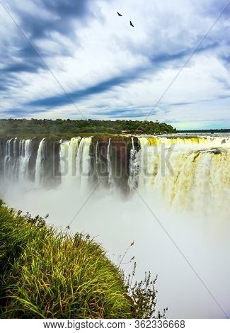 The most full-flowing waterfall in the world on the Parana River. The Garganta del Diablo. Concept of active and ecological tourism