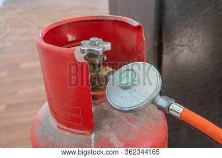 Connecting Hose With Flap To Gas Cylinder, Red Gas Cylinder Close-up