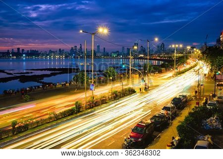 Mumbai famous iconic tourist attraction Queen's Necklace Marine drive in the night with car light trails. Mumbai, Maharashtra, India