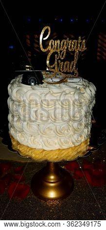 Delicious Three Tier Buttercream Frosting Graduation Cake