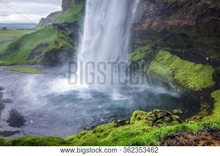 South Region, Iceland - June 9, 2018: Famous Seljalandsfoss Waterfall On Seljalands River That Has I