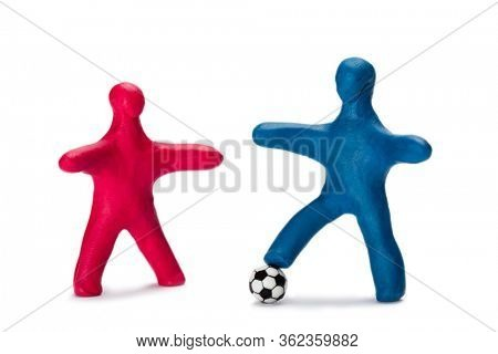 Plasticine small people soccer players with ball isolated on white