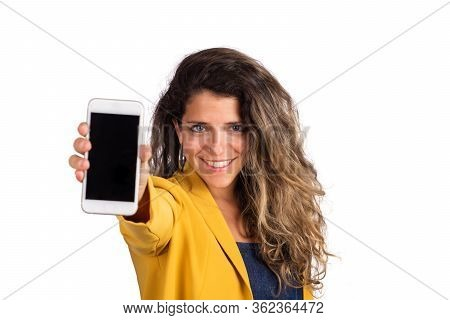 Young Woman Showing Blank Smartphone Screen.