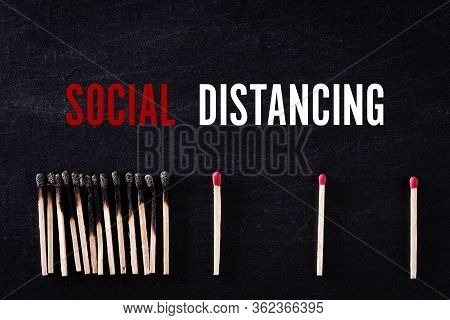 Social Distancing Concept. Matchsticks Burn, One Piece Prevents The Fire From Spreading By Far From