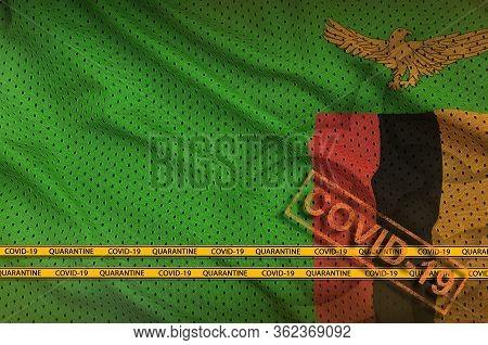 Zambia Flag And Orange Covid-19 Stamp With Border Tape. Coronavirus Or 2019-ncov Virus Concept