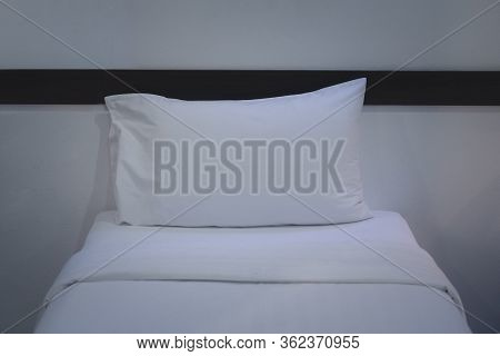 White Bedding And Pillow In Hotel Room. Comfort And Bedding Concept