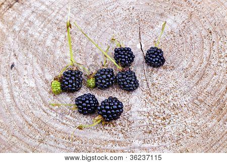 Blackberry On Wooden Background