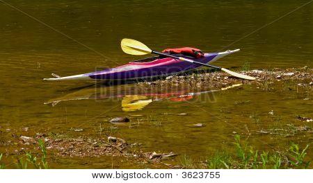 Canoe On A River Bank