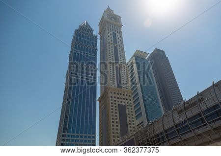 Flyover Over The Road Against Blue Sky And High Residential And Office Buildings Automobile Bridge O