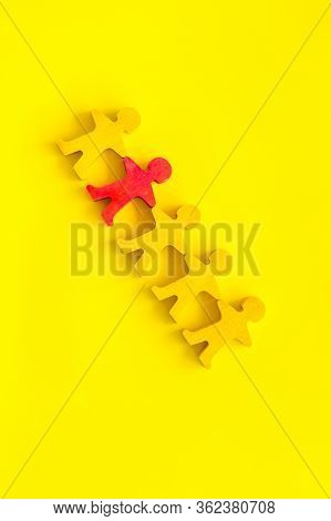 Teamwork, Teambuilding Concept. Wooden Figures Of People On Yellow Background Top View