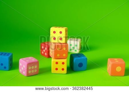 Cube With Numbers.bouncing Dice. Multicolored Cubes Set On A Green Background. Numbers And Symbols.