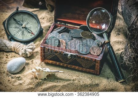Pirate Treasure Chest With Ancient Coins And Other Various Pirate Equipment On Flat Lay Table Backgr
