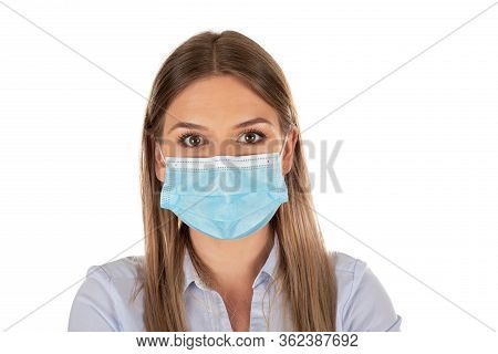 Beautiful Caucasian Woman Wearing Protective Face Mask , Posing On Isolated Background