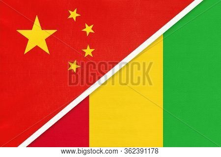 China Or Prc Vs Guinea National Flag From Textile. Relationship Between Asian And African Countries.