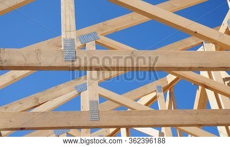 Unfinished Roofing Construction On A Stage Of Roof Framing Done With Trusses, Braces, Roof Beams Aga