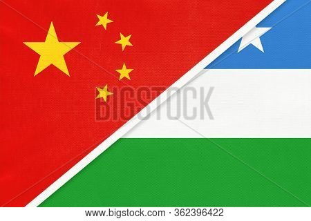 China Or Prc Vs Puntland State Of Somalia National Flag From Textile. Relationship Between Asian And