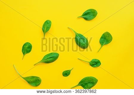 Food Background Of Spinach Leavs On Yelow Background