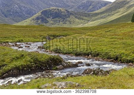River Bà & Meall Tionail (582m) With The Ridge Of Aonach Mor Behind, From West Highland Way At Bà Br