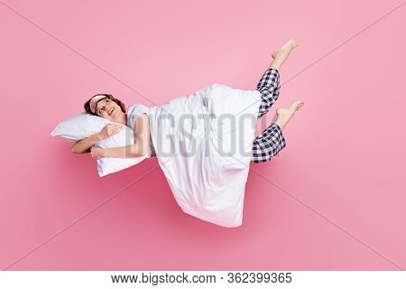 Full Size Photo Of Cheerful Lady Satisfied Morning Nap Lying Bed Hug Pillow Blanket Raise Legs Up We