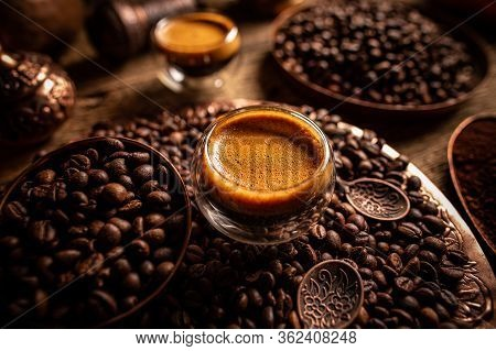 Espresso Shot And Coffee Beans, Dark Toned Background