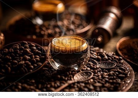 Coffee Brewing Concept. Espresso In Glass Cup And Coffee Beans