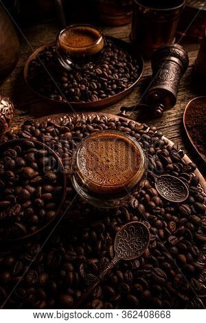 Glass Cup With Espresso Coffee On Coffee Beans Background