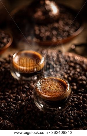 Hot Coffee In A Glass With Double Walls On Coffee Beans Background