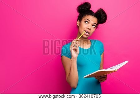 Photo Of Pretty Funny Dark Skin Lady Two Buns Hold Pencil In Mouth Look Up Empty Space Writing Notes