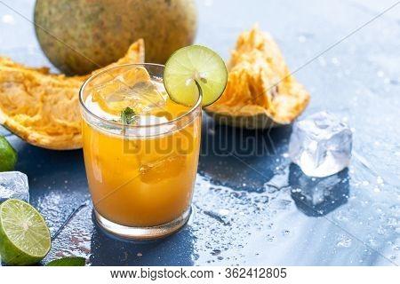 Exotic Fruit Juice From Bel Fruit Or Wooden Apple Called In India Bel Ka Sharbat. Cold Fruit Drink W