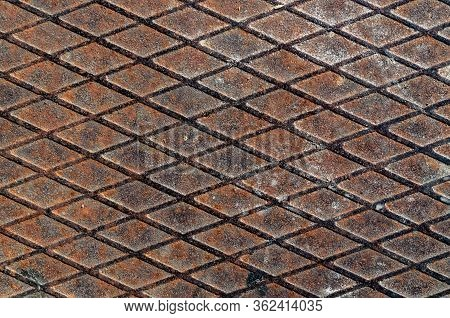 Rolled Steel Fluted Sheet With Rust And Traces Of Time. Rolled Steel With A Diamond Pattern.