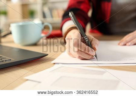 Close Up Of Student Girl Hands Writing Letter On A Desk At Home