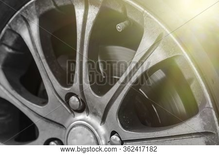 Alloy Wheel With Dirt And Oil. A Close-up Of A Road Wheel Covered With Road Dust And Dirt. Return Af
