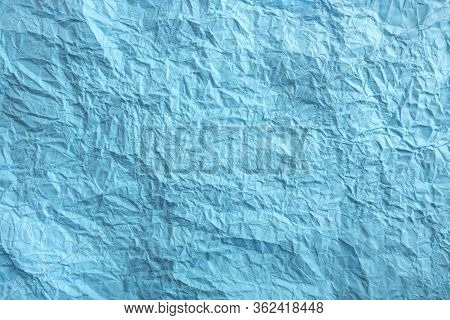 Blue Crumpled Paper Background. Twisted Blue Paper. Seamless Pattern.