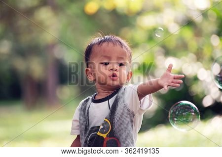 Asian Poor Children Playing Bubble In Nature Background.close Up Headshot Elementary Boy Happy Fun I