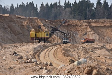 Largest Mining Excavator With Electric Shovel Loading Sand Into Dump Truck In Opencast. Orange Minin