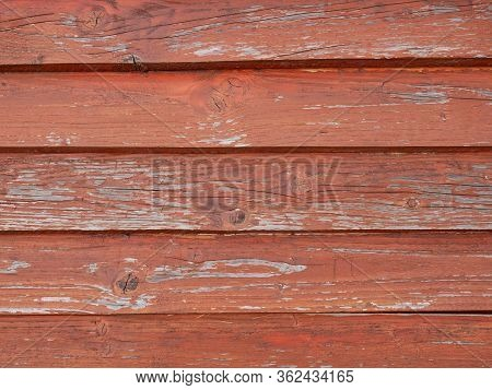 Old Weathered Wooden Roof Pained In Red