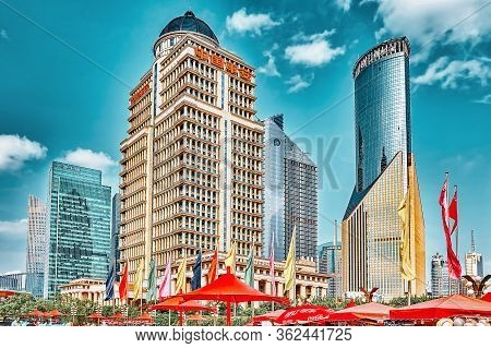 Shanghai, China- May, 24, 2015: Skyscrapers, City Building Of Pudong, Peoples On The Street, Tourist