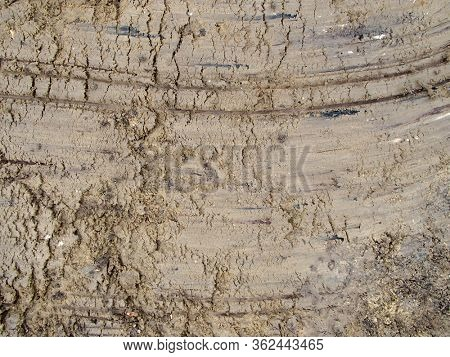Wet and Marked Earth Textured Background
