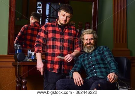 Hairstylist In Barbershop. Man In Hair Salon With Hipster Haircut. Beard And Mustaches. Professional