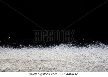 White Wheat Flour Scattered On A Black Background, Wheat Flour Texture, Background For Baking And Co