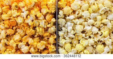 Popcorn Background Close-up. Assorted Popcorn In A Movie Theater Behind A Glass. Texture Of Popcorn.
