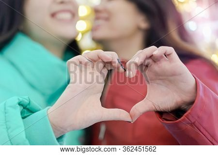 Two Lesbians Making Heart With Hands, Free Expression Of Love, Lgbt Rights. Girls Making A Heart-sha