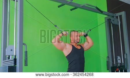 Athletic Young Man Working Out On Fitness Exercise Equipment At Gym, Fitness Club. Health, Sport And